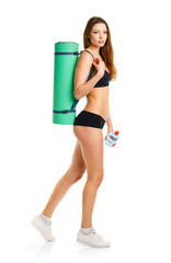 Beautiful athletic woman withmat for fitness, bottle of water do