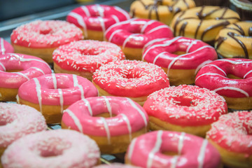 Sweet donuts arranged at display