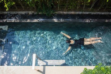 woman is relaxing on the private pool villa