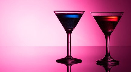 Colorful cocktails on reflective top