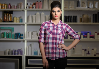 Young woman in cosmetics shop
