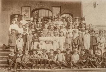 Antique portrait of school classmates. Children and teachers