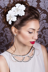 girl with bright makeup with red lips white flowers in hair