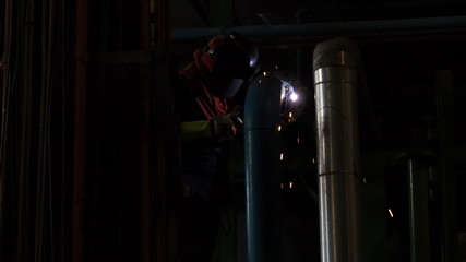 Industrial workers welding on an industrial plant.