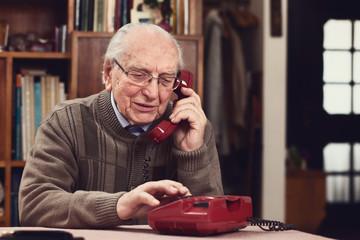 Senior at old telephone