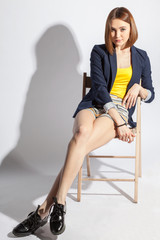 Adult girl relaxing on a chair
