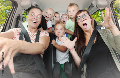 Crazy family taking a selfie in the car. Vintage filtered look - 79580056