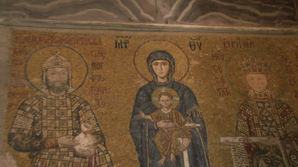 ZO OF A PAINTING OF VIRGIN MARY AND BABY JESUS ON A WALL