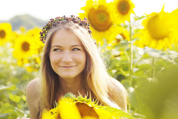 girl smiling in sunflowers