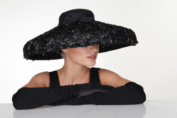 Elegant Woman Wearing Black Hat and Gloves