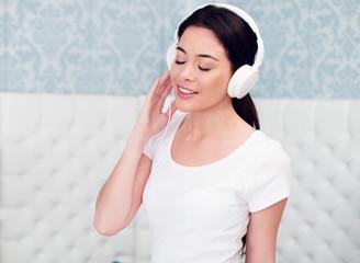 Pretty Woman Enjoying Music Using Headphones