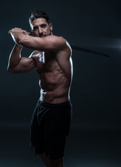 Gorgeous Shirtless Muscled Man Holding a Sword