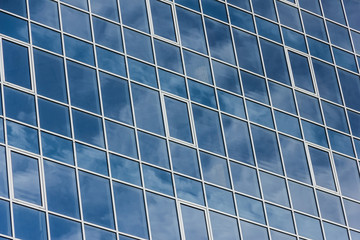 The glass facade of a tall building