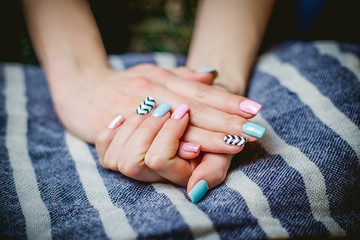 Girl shows blue manicure