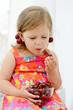 little girl eating merry