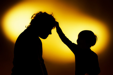 Two  expressive boy's silhouettes showing emotions using gesticu
