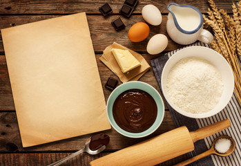 Baking chocolate cake - ingredients and blank paper - background
