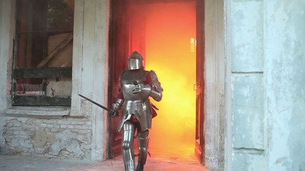 Knight rushes out the door of the palace in the fire