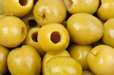 Abstract background: green pitted olives.