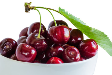 Cherry berries in a cup on a white background