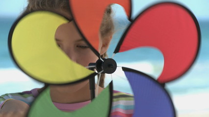 CU OF A GIRL SPINNING A PIN WHEEL