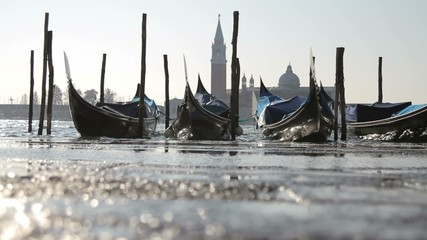 Moored gondolas at sunset, San Giorgio Maggiore in background, Venice, Veneto, Italy