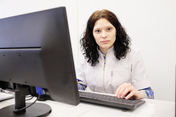 Doctor woman sitting on her office with computer