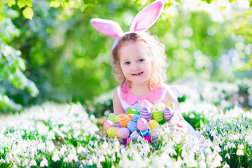 Beautiful little girl at Easter egg hunt