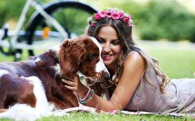 Beautiful girl with a dog