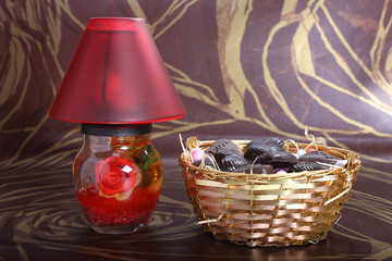 home made chocolates in metal bowl with decorated lamp