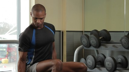 Male lifting weights in gym