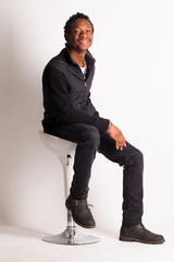 Handsome black guy sitting on a chair