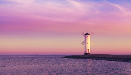 Purple sunrise over Baltic Sea coast.