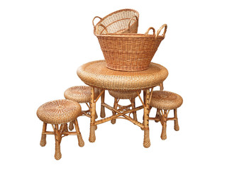 Wicker furniture - table, chair and baskets isolated over white