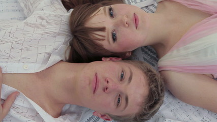 Young Man And Woman Lying Together. Open Eyes