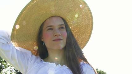 Pan portrait of female wearing hat