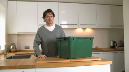 MS PAN OF A MAN CARRYING A RECYCLING BOX