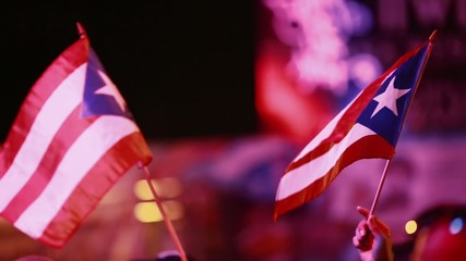 Two Puerto Rican Flags being held at Festival