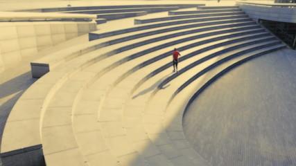 Runner on steps City hall London, UK, Slow motion, wide shot
