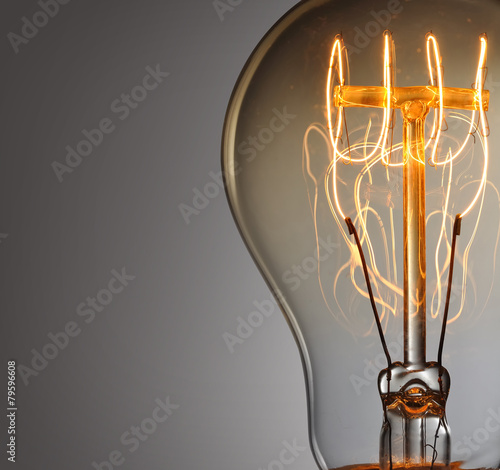 Close up glowing vintage light bulb - 79596608