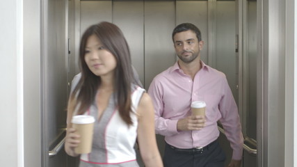 Office workers in elevator