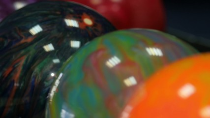 Colored bowling balls in the bollmachine. Сamera moves from