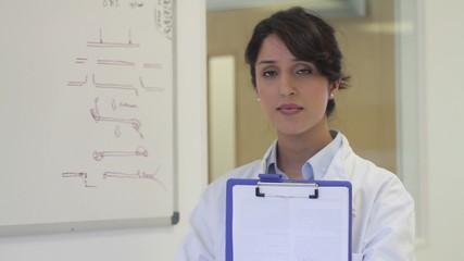 Portrait of female scientist in laboratory
