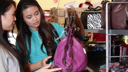 MS, Females looking in shop at handbags