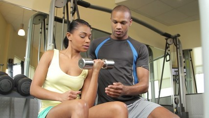 Female and male coach, working out in gym