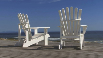 Zoom out on relaxing chair and blue sky