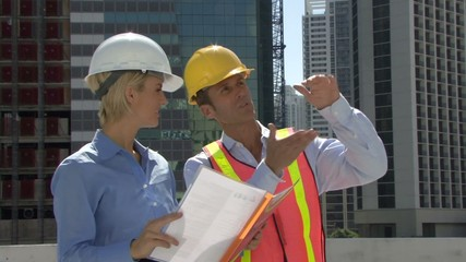 Male and female construction workers on a site