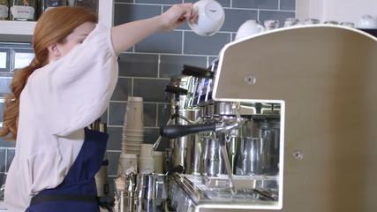 Woman using coffee maker