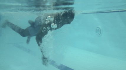 Male swimming in swimming pool in gym