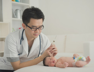asian newborn at hospital with doctor